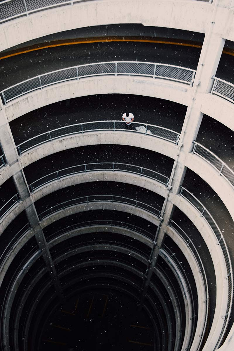 A man standing in a downtown Edmonton parking structure
